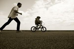 kid-rides-bike-business-education